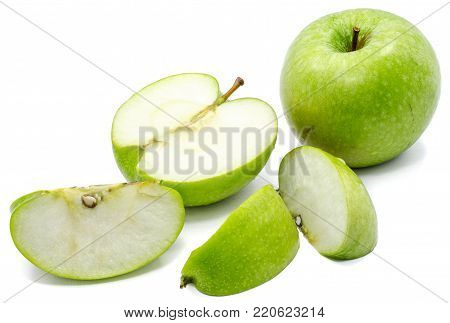 Sliced apple Granny Smith, one whole, three slices and one half, isolated on white background poster