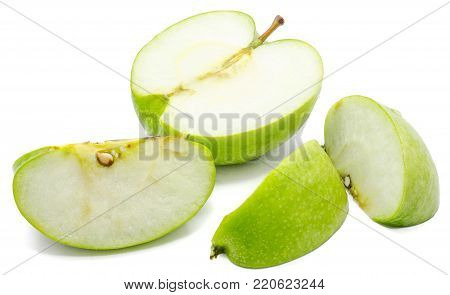 Sliced apple Granny Smith, three slices and one half, isolated on white background