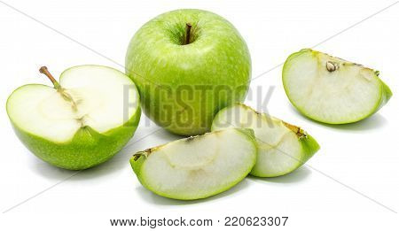 One whole apple Granny Smith, three slices and one half, isolated on white background