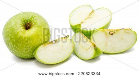 One whole apple Granny Smith, slices and one half, isolated on white background