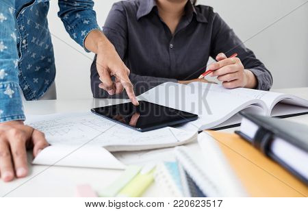 Tutor book with friends, Young students campus or classmates helps friend catching up workbook and learning tutoring in classroom, teaching, learning, People, technology, Education school concept.