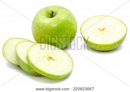Sliced Granny Smith apples, one whole apple, one half and circles, isolated on white background