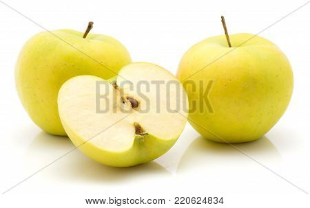 Apples (Smeralda variety) isolated on white background green yellow two whole and one half cross section