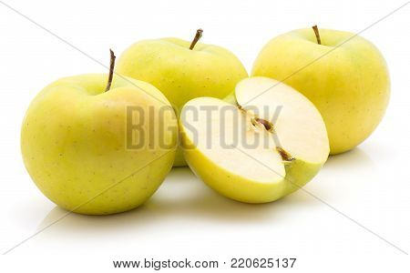Apples (Smeralda variety) isolated on white background green yellow three whole and one half cross section