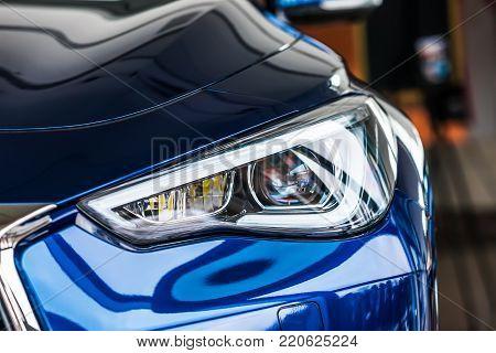 Macro view of modern blue car headlight