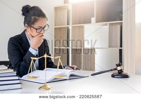 Judge gavel with scales of justice, professional female lawyers working having at law firm in office. Concepts of law.