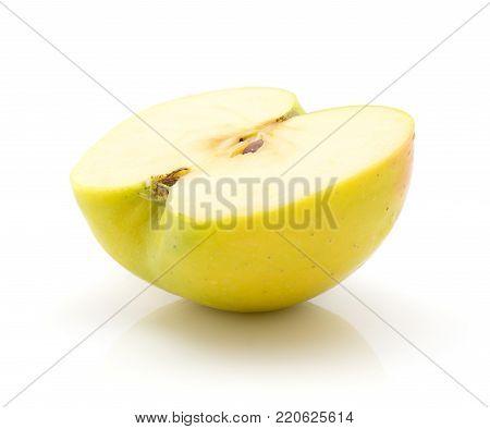 One apple (Smeralda variety) half isolated on white background green yellow
