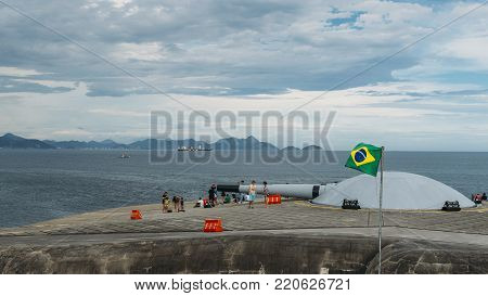 Rio de Janeiro, Brazil - Jan 3rd, 2018: Tourists next to a Turret with two 190 mm guns at Fort Copacabana, Rio de Janeiro, Brazil used as a defence of the city