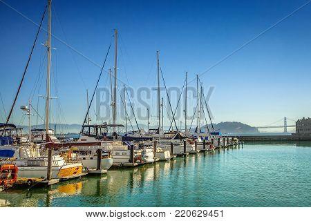 Boats and yachts at marina on sunny morning