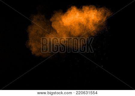 Abstract Orange Powder Explosion On Black Background. Abstract Orange Dust Splattered On  Black Back