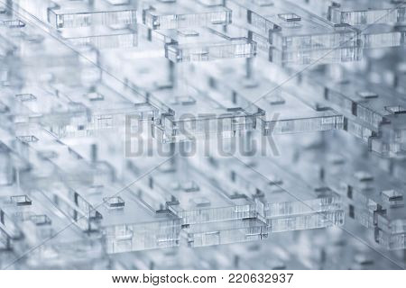 Abstract high-tech background. Details of transparent plastic or glass. Laser cutting of plexiglass.