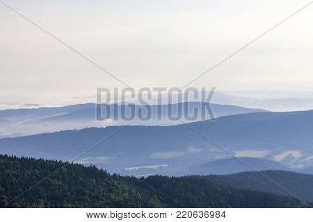 Morning landscape in haze in National park Bayerische Wald,  view from the mountain Grosser Arber, Germany.