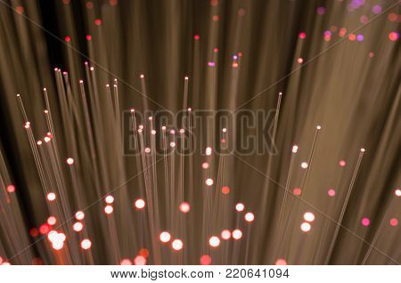 Red optical fibre close up macro shot for background image .