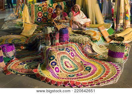 KOLKATA, WEST BENGAL , INDIA - DECEMBER 3RD 2016 : Unidentified woman preparing jute bags, artworks of handicraft, Handicraft Fair in Kolkata - the biggest handicrafts fair in Asia.