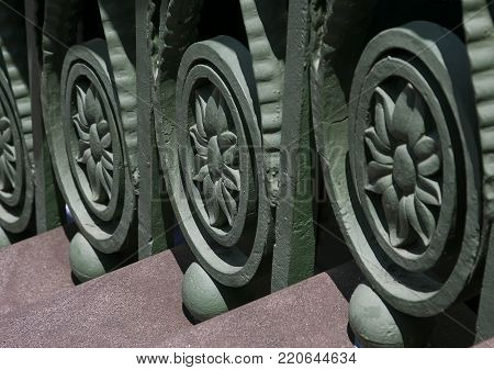 Ornate wrought iron floral designs adorn the balusters of historic steps in Charleston, South Carolina
