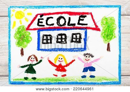 Photo of  colorful drawing: French word SCHOOL, school building and happy children. First day at school.