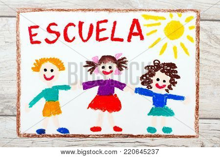 Photo of  colorful drawing: Spanish word SCHOOL and happy children. First day at school