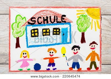 Photo of  colorful drawing: German word SCHOOL, school building and happy children. First day at school.
