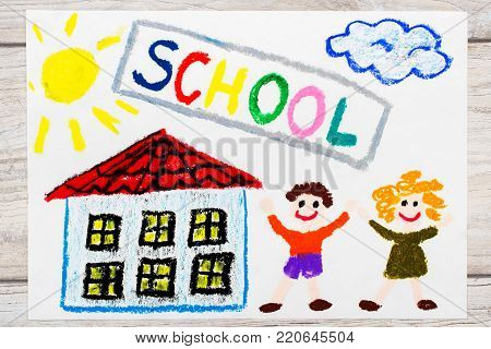 Photo of  colorful drawing: Word SCHOOL, school building and happy children. First day at school.