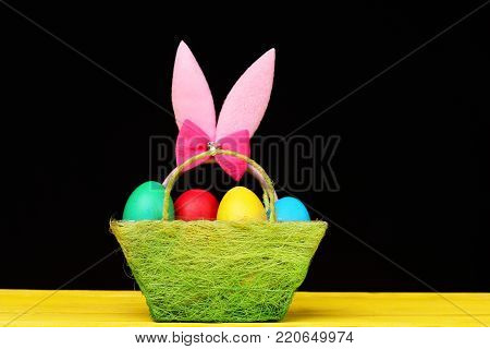 Easter Symbols Concept. Fluffy Rabbit Ears With Colorful Eggs