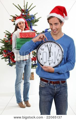 Couple eagerly waiting for Christmas Day to open presents