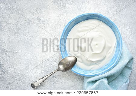 Natural Yogurt In A Bowl For A Breakfast.top View With Copy Space.