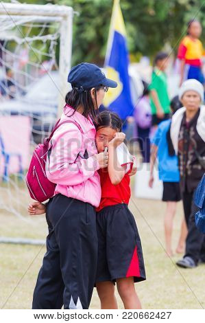 CHIANGRAI, THAILAND - DECEMBER 29: unidentified loser girl crying with her mother after competition on December 29, 2017 in Chiangrai, Thailand.