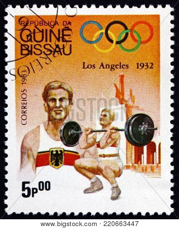 GUINEA-BISSAU - CIRCA 1983: a stamp printed in Guinea-Bissau shows weightlifting, 1984 Summer Olympics, Los Angeles, circa 1989