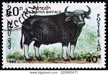 LAOS - CIRCA 1990: a stamp printed in Laos shows water buffalo, bubalus arnee, is a large bovid, circa 1990