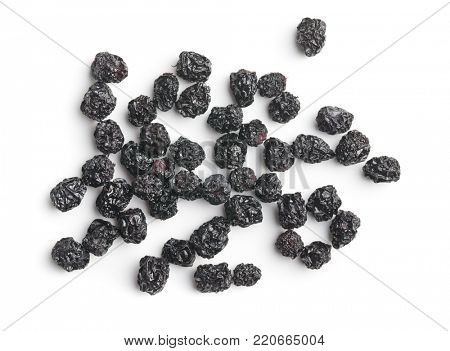 Dried chokeberries. Black aronia berries isolated on white background.