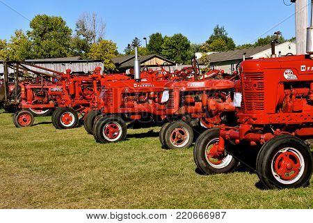 DALTON,  MINNESOTA, Sept 8, 2017: A collection of Farmall tractor models are displayed at the annual Dalton Threshing Bee farm show in Dalton held each 2nd full weekend in September where 1000's attend.