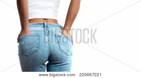 Woman wearing of jean pants from back. Female bottom in tight jeans