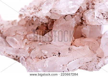 Himalayan clear quartz cluster with hematite inclusions isolated on white background