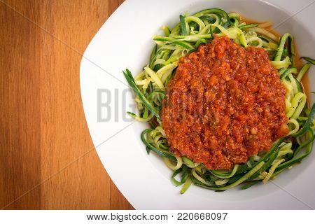 zucchini spaghetti spiral with tomato sauce hign angle view