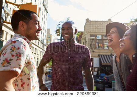 Group Of Friends Meeting On Urban Street In New York City