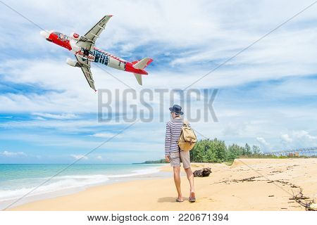PHUKET, Thailand - October 23, 2017 : Air Asia airplane flying take off at Phuket International Airport, Mai Khao Beach, Phuket province, Southern of Thailand.