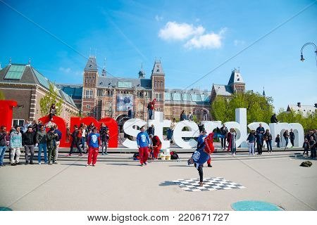 Amsterdam, Netherlands - April 20, 2017: Youth break dancing on city streets in Amsterdam. Street festival breakdance.