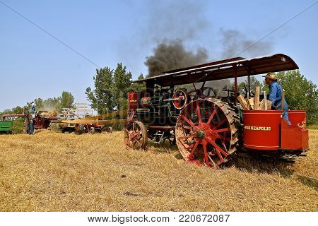 ROLLAG, MINNESOTA, Sept 4 2017: A  Minneapolis steam engine powers a threshing machine at the the annual WCSTR farm show in Rollag held each Labor Day weekend where 1000's attend.