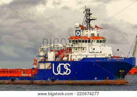 Labuan,Malaysia-Aug 30,2017:View of platform supply vessel (PSV) offshore support vessel,ready to the offshore oil production fields from port at Labuan,Malaysia.
