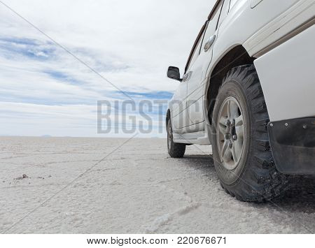off-road vehicle driving on Salar de Uyuni