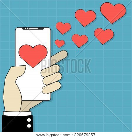 Red heart on mobile smartphone screen with red hearts flying away from screen isolated on blue wall background. Internet dating Valentines day concept.