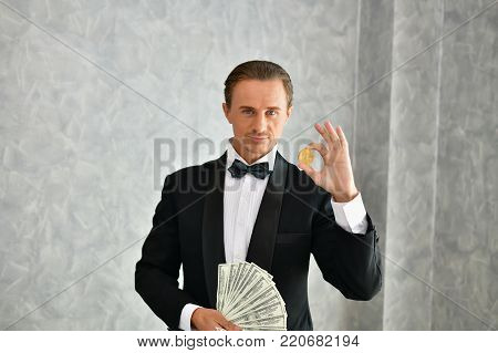 Concept Very wealthy businessman. Businessman is happy with his money.A businessman showing his money.
