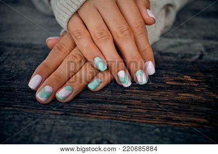 Gentle manicure on a wooden background .Natural nails, gel polish. Stylish Nails, Nailpolish.