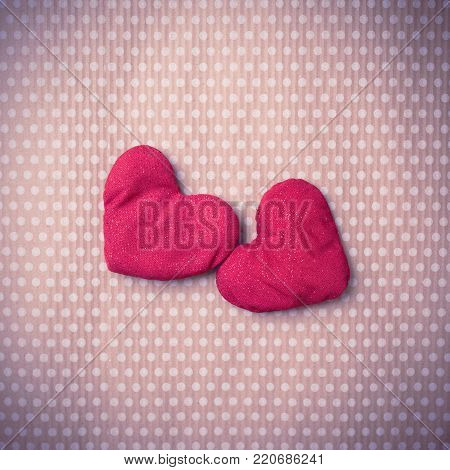 Valentine's Day. Colorful knitted hearts. Valentines day. Heart pendant. Vintage background in peas. Red heart. Handmade Hearts. Valentine cards. Space for text. Toned image.