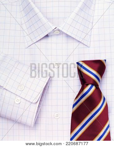 white checkered male shirt and striped tie