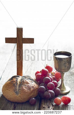 Easter bread  wine and cross on vintage old wooden background