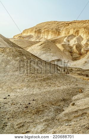 View on heat desert sunny land near dead sea in Israel. Valley of sand, mountains and stones in hot middle east tourism place. Scenic outdoor infinity on wild land. Summer heat and nobody on photo