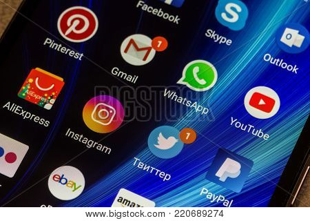 Adygea, Russia - January 3, 2018: WhatsApp, YouTube, instagram, Facebook, Skype and other app icons on the smartphone screen Xiaomi