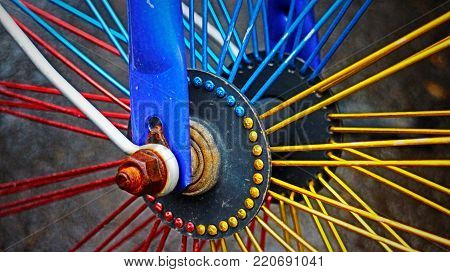 Colourful Bicycle Wheel Spokes in horizontal 16:9 format.