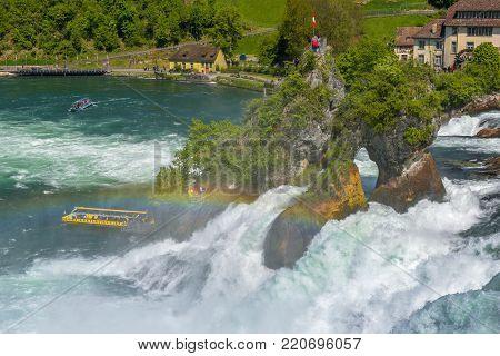 Rhein waterfall, Germany - April 2017: cruise boat at Rheinfall basin on a bright day